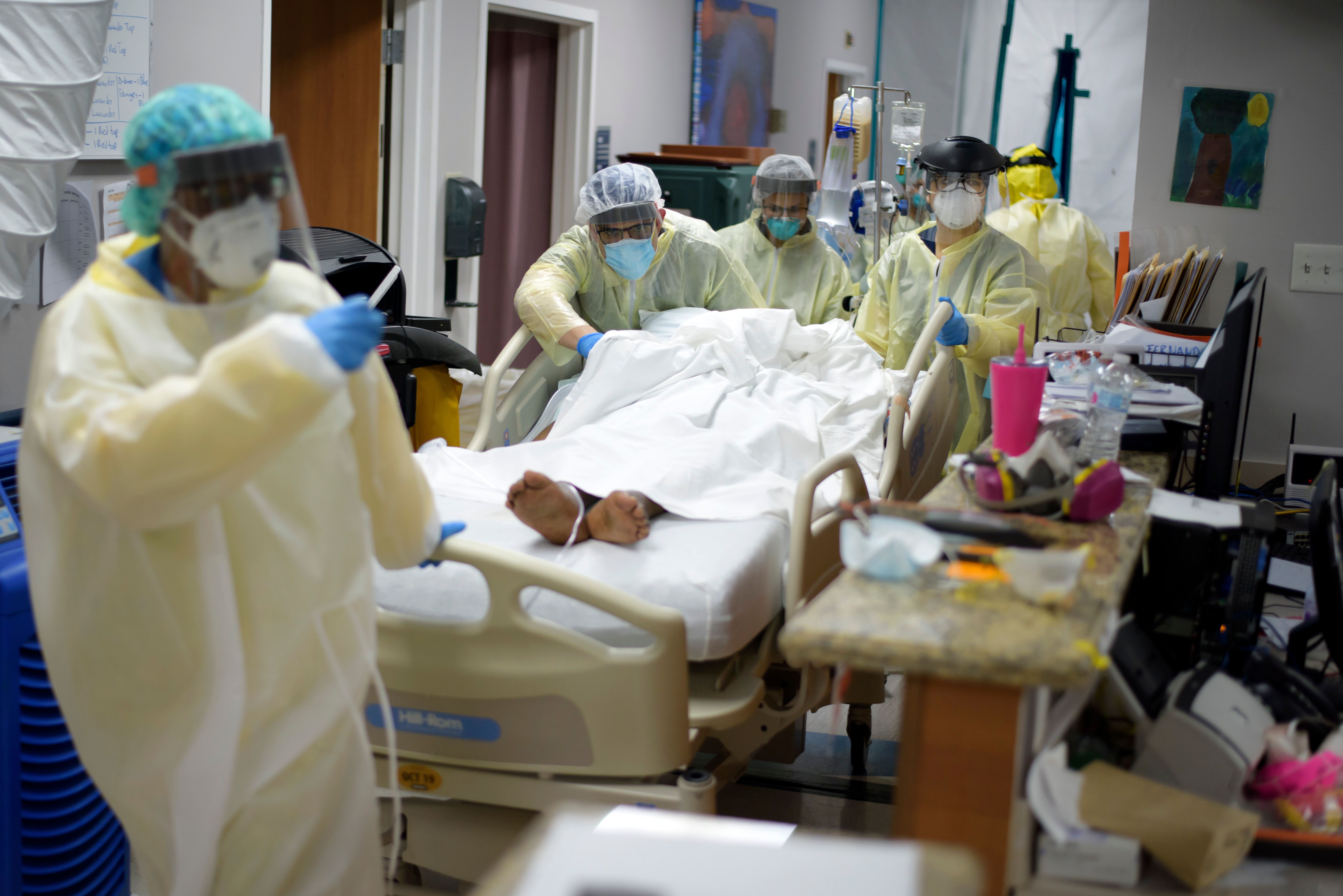 U.S. hospitals scramble to adopt new HHS coronavirus data system, some states see 'data blackout'